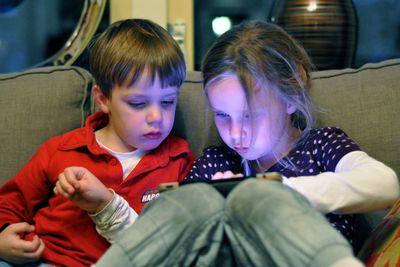 Kids using an iPad