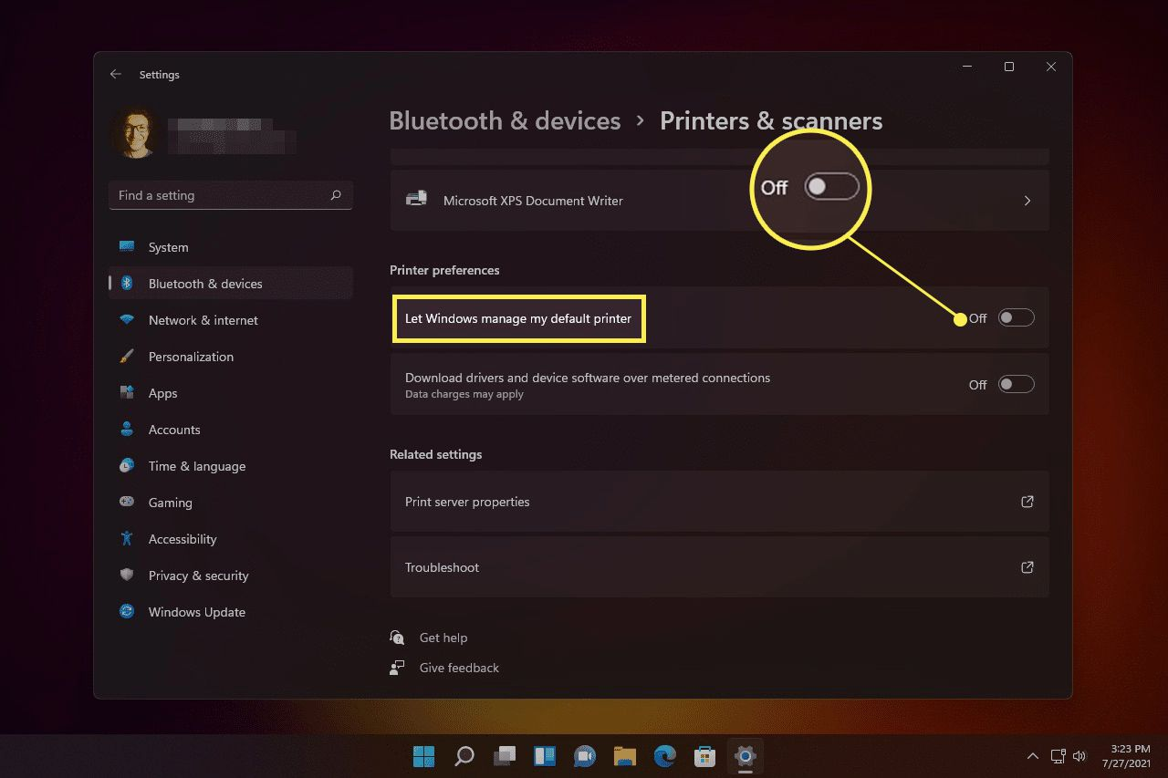 Let Windows manage my default printer and off toggle highlighted in Windows 11 settings