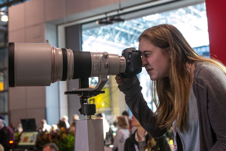 Photographer using a telephoto lens
