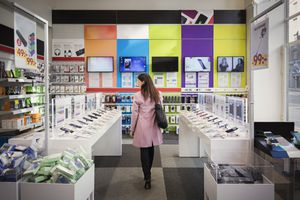 Woman in phone store