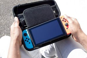 Man holding Nintendo Switch in a case