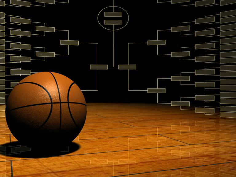 Basketball on a court floor superimposed in front of a bracket system