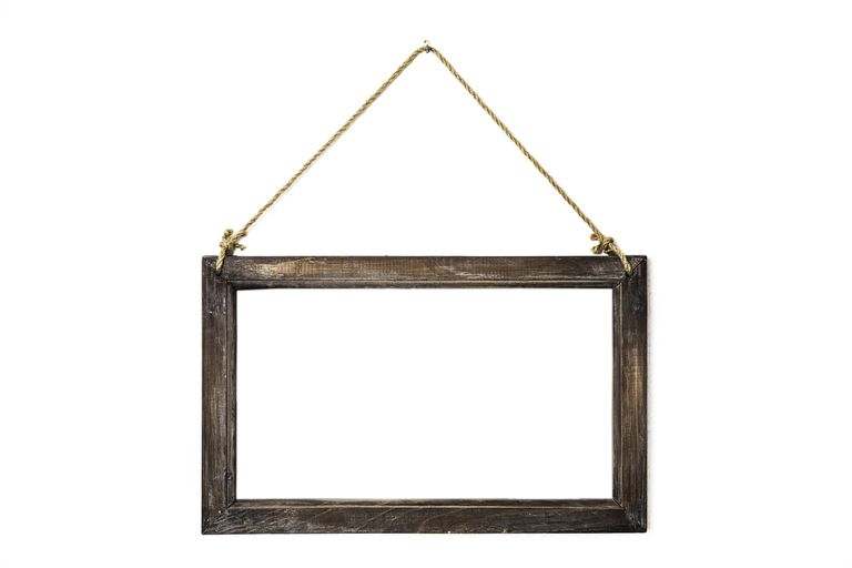 Wooden frame hanging by rope centered