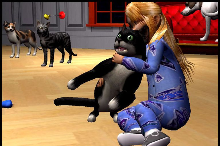 Child holding a virtual pet in a Sim 2 Pets scene