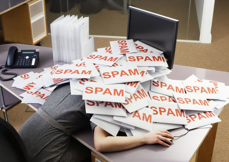 office worker with spam email at desk