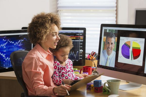 Working mom with child watching shared conference screen
