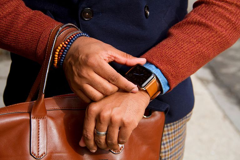 A woman wearing an Apple Watch.