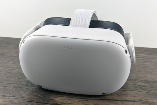 An Oculus Quest sitting on a table.
