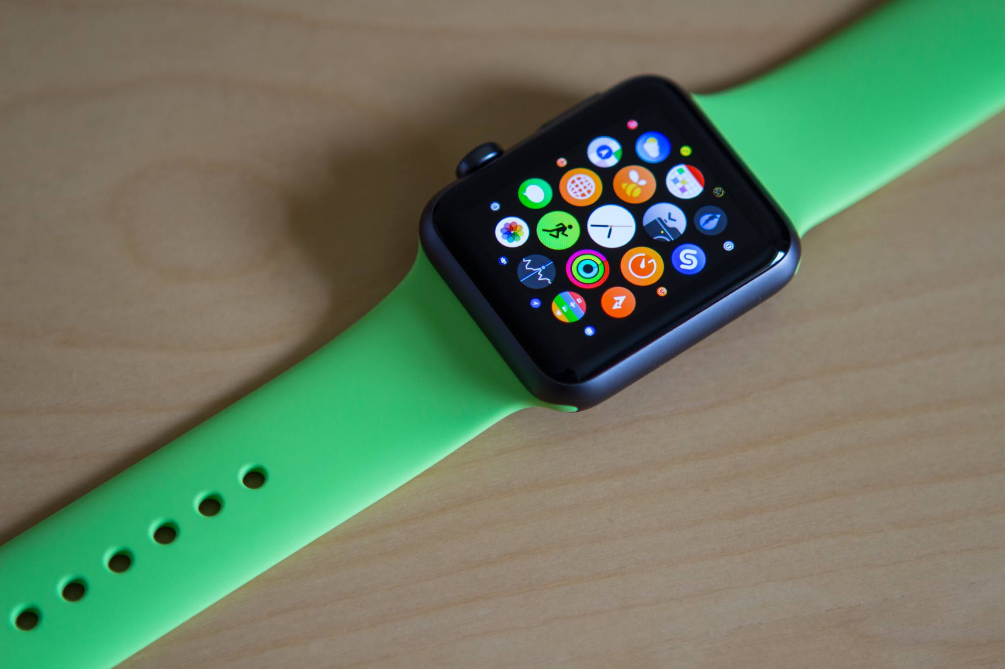 Apple Watch with green Sport band on a table