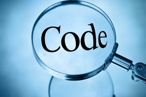 Magnifying glass magnifying the word code in a blue tone in square format
