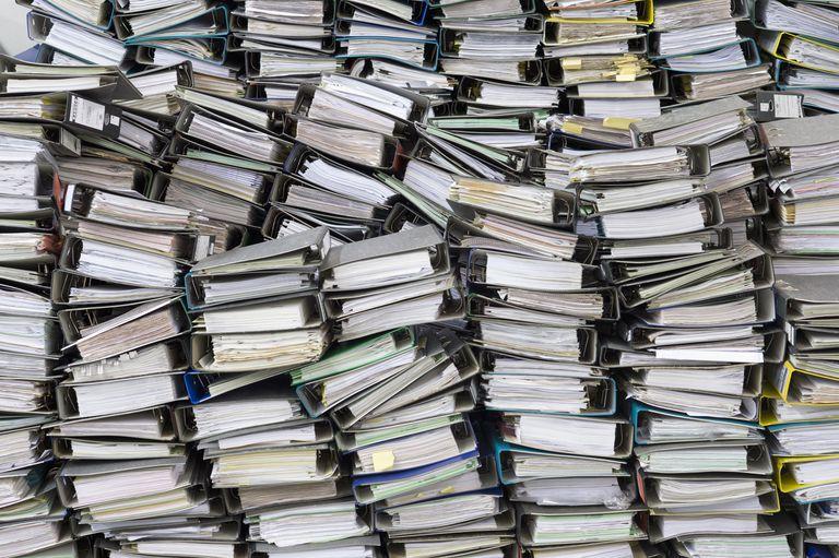 Huge pile of office binders