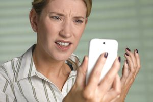 Image of woman frustrated with her phone.
