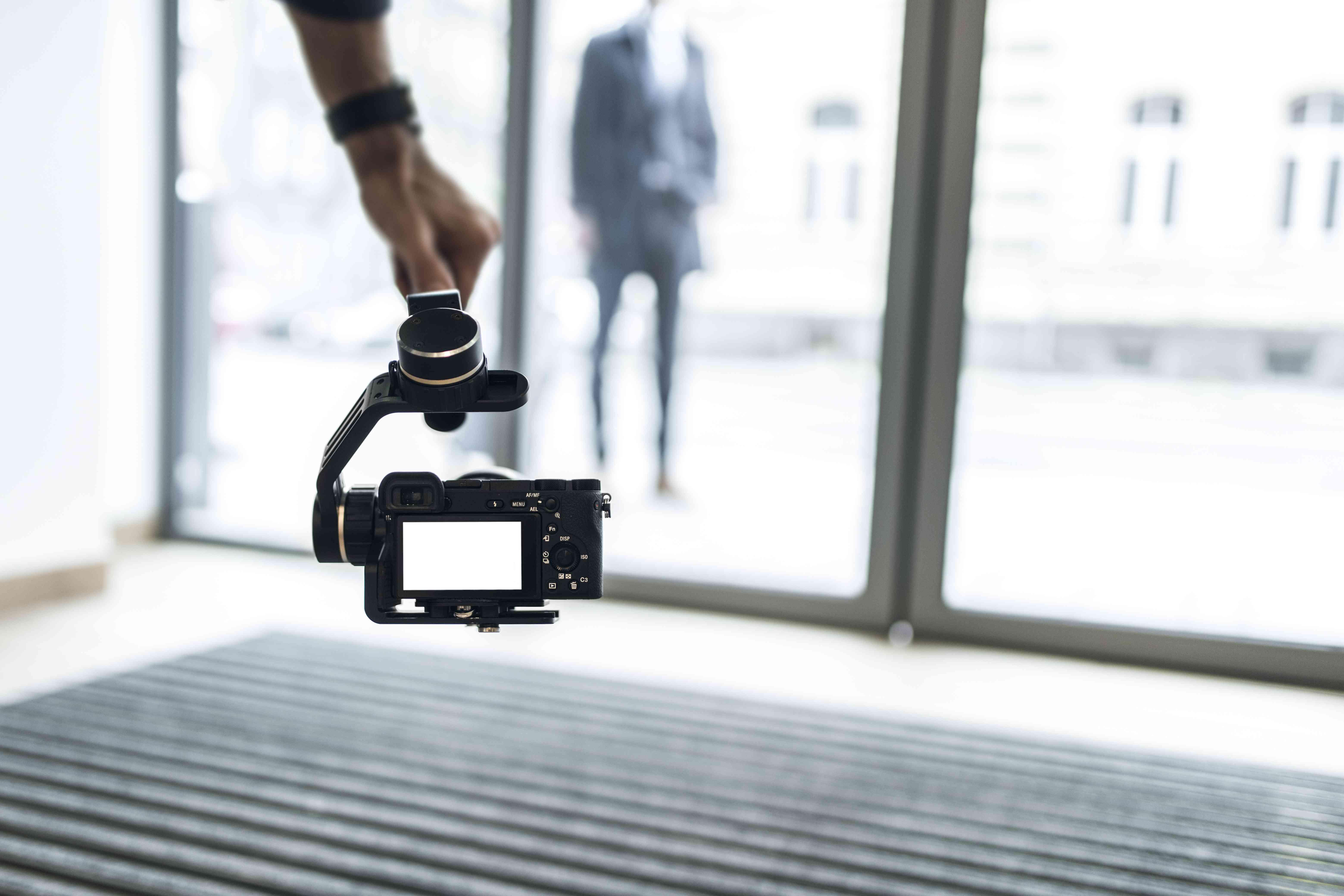 A videographer shooting using steadicam