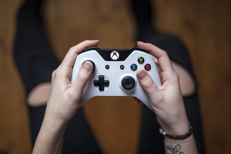 Xbox One White Controller in person's hands