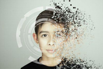 Boy who is becoming pixelated.