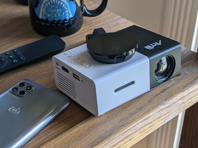 An Android phone connected to a mini projector.