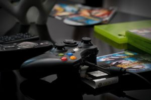 Picture of an Xbox controller and some Xbox games