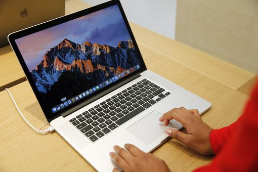 A MacBook Pro on a table at an Apple store.