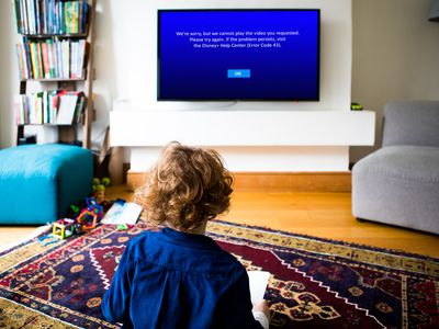A child sees Disney Plus error code 43 on a television.