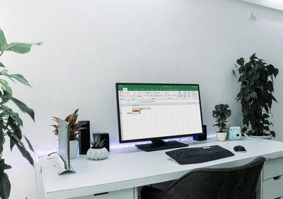 A PC on a desk displaying Excel.