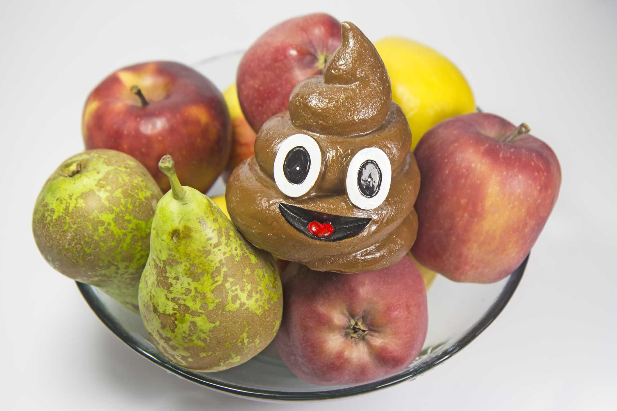 A 3D poop emoji in a bowl of fruit