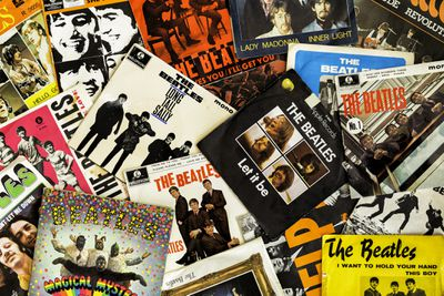 Stacks of album covers from The Beatles
