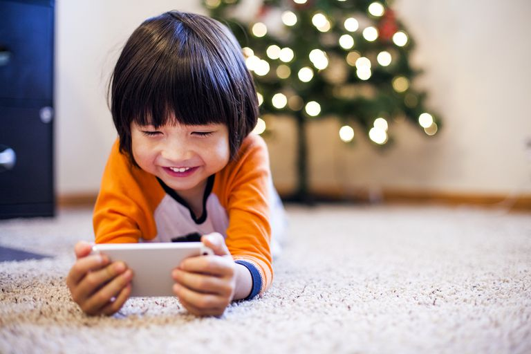 Kid playing with iPhone