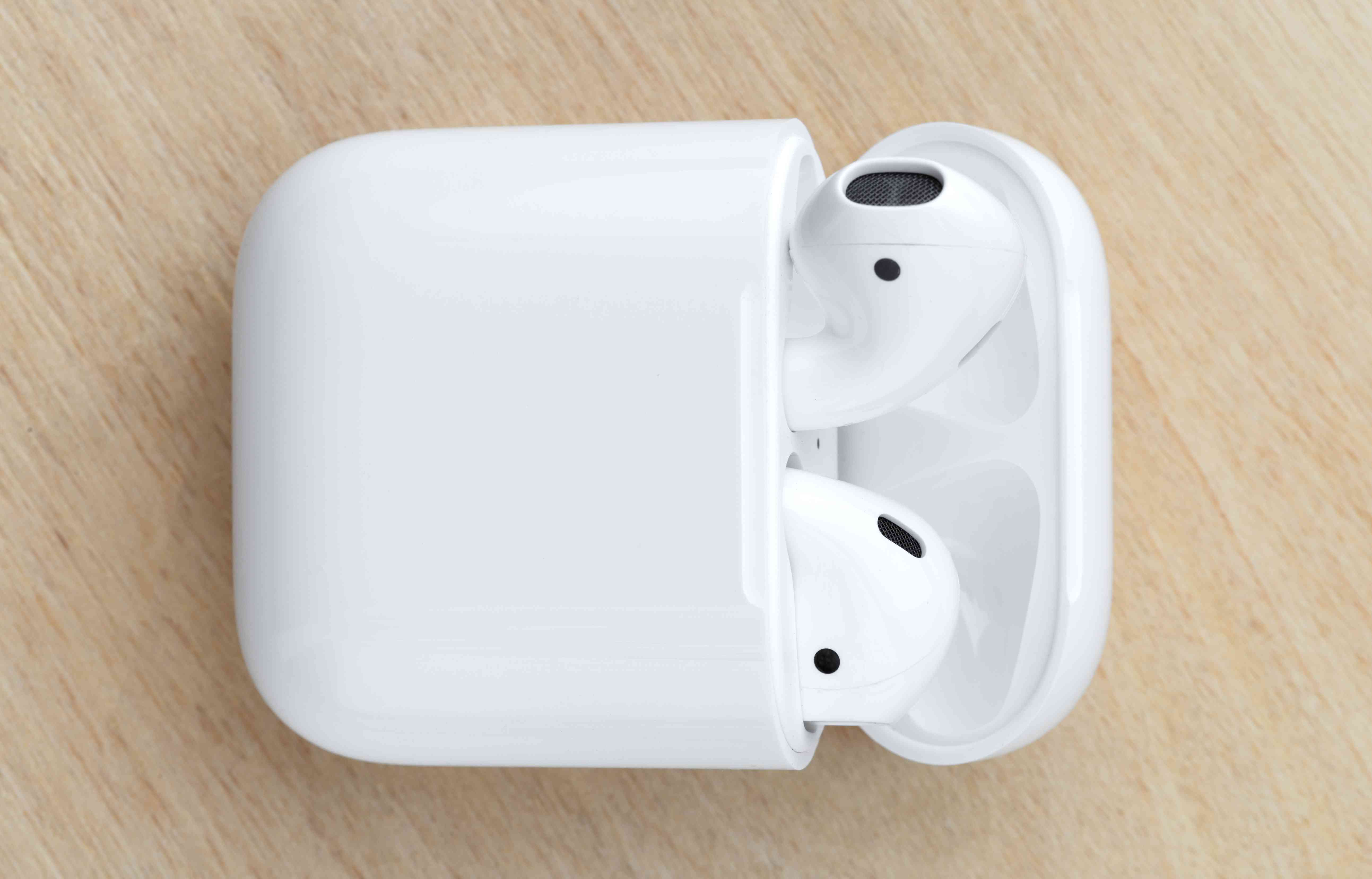 Place your Apple AirPods back in their charging case and close the lid, then wait a few seconds.