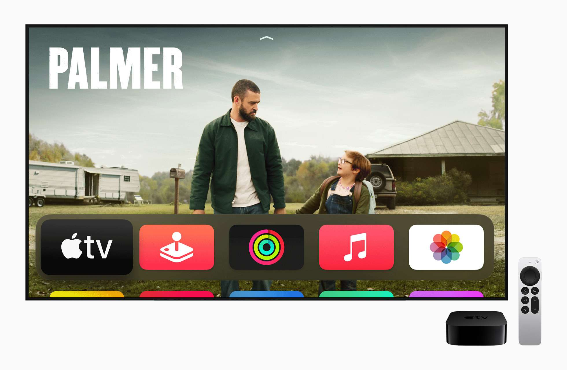 4K Apple TV and Remote next to a television screen displaying Apple TV apps and a screen from
