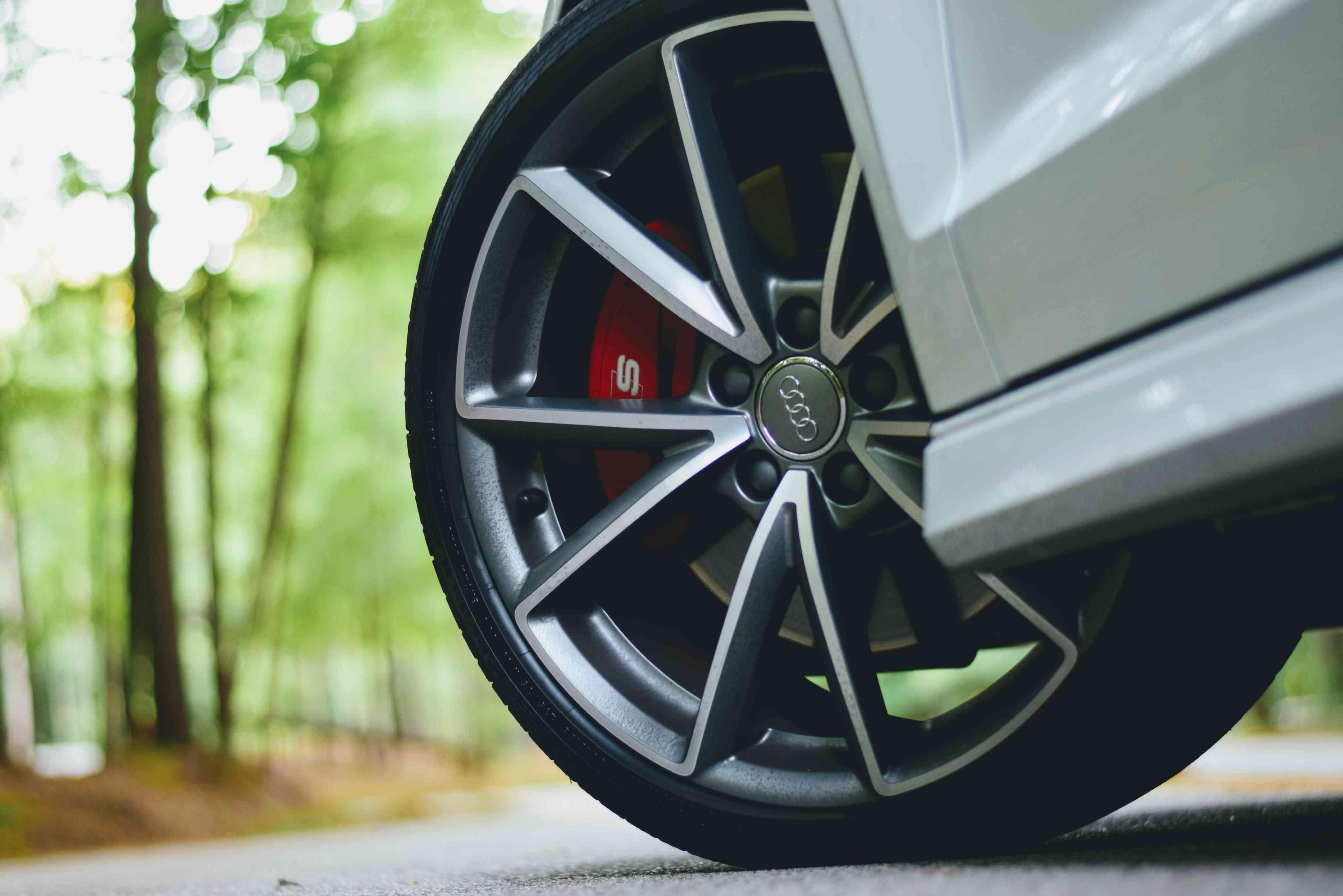 Closeup of an Audi tire.