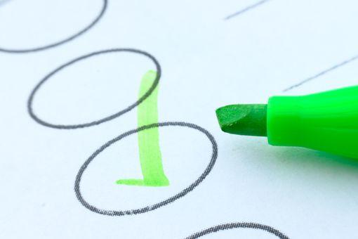 Macro shot of drawing green check mark in checklist box-go green idea