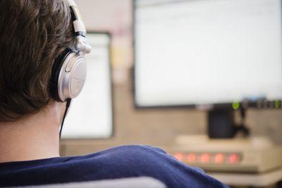 Man listening to headphones at work