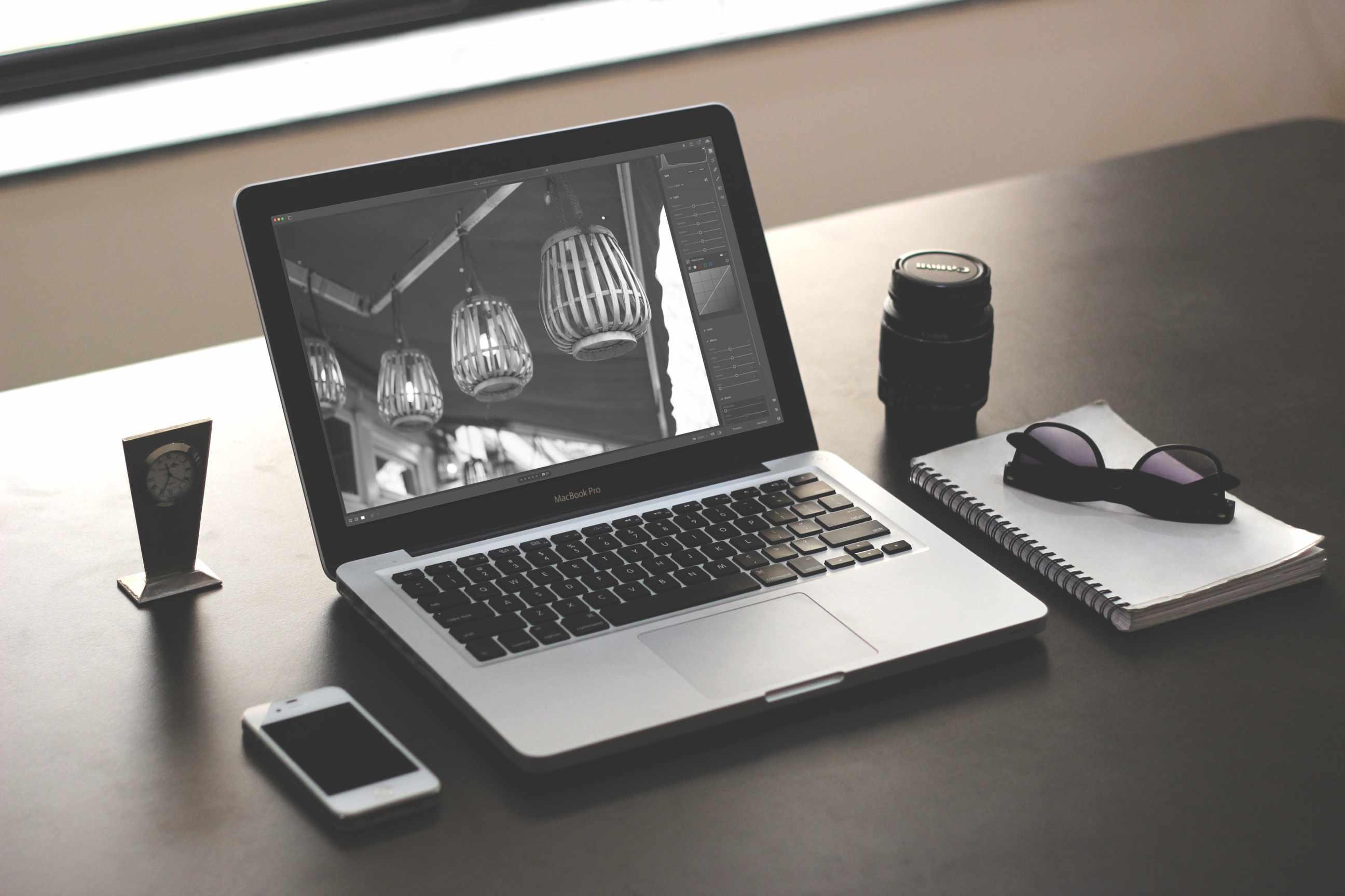 A Charlie Sorrel photo in Adobe Lightroom displayed on a MacBook Pro laptop.