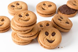 Pile of smiley sandwich cookies.