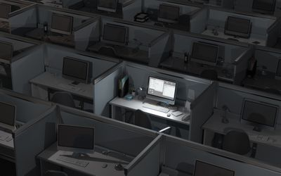 Dark office with many computers, one lit up