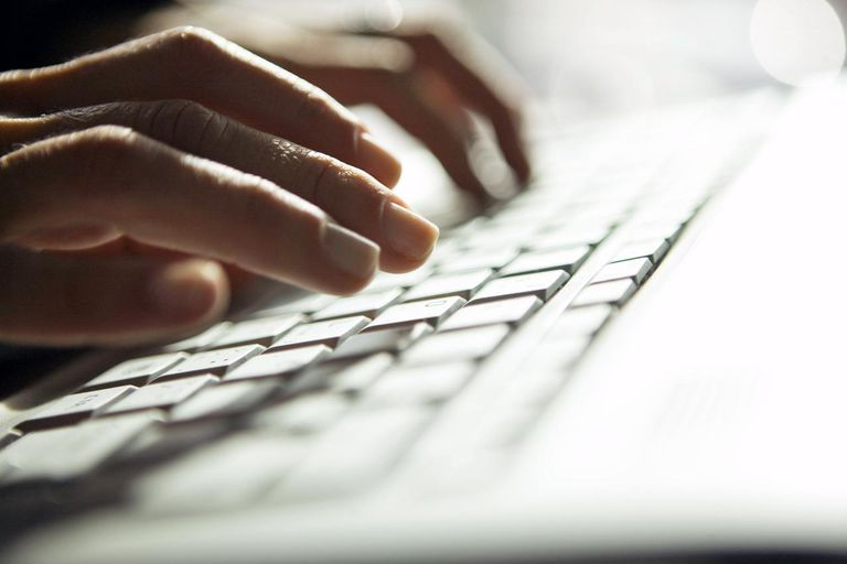 Picture of hands typing on a keyboard