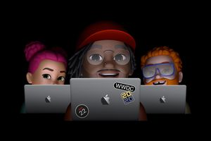 Three emojis peering over MacBooks, one with a WWDC 2020 sticker on it