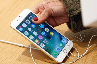 A customer checks an iPhone 7 inside an Apple store