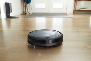 A Roomba i3 cleaning the floor