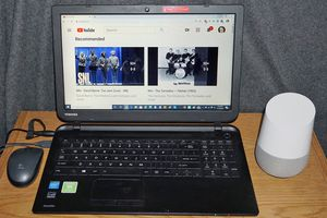 Google Home and a laptop using YouTube.
