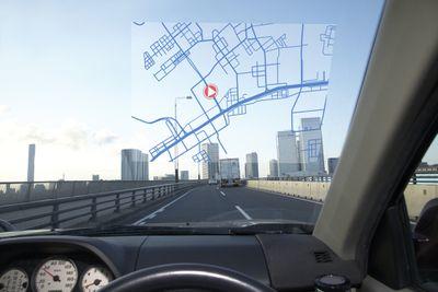 GPS screen in car windshield, skyline ahead