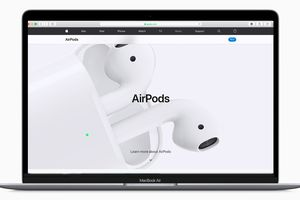 A MacBook Air with the AirPods webpage displayed on it