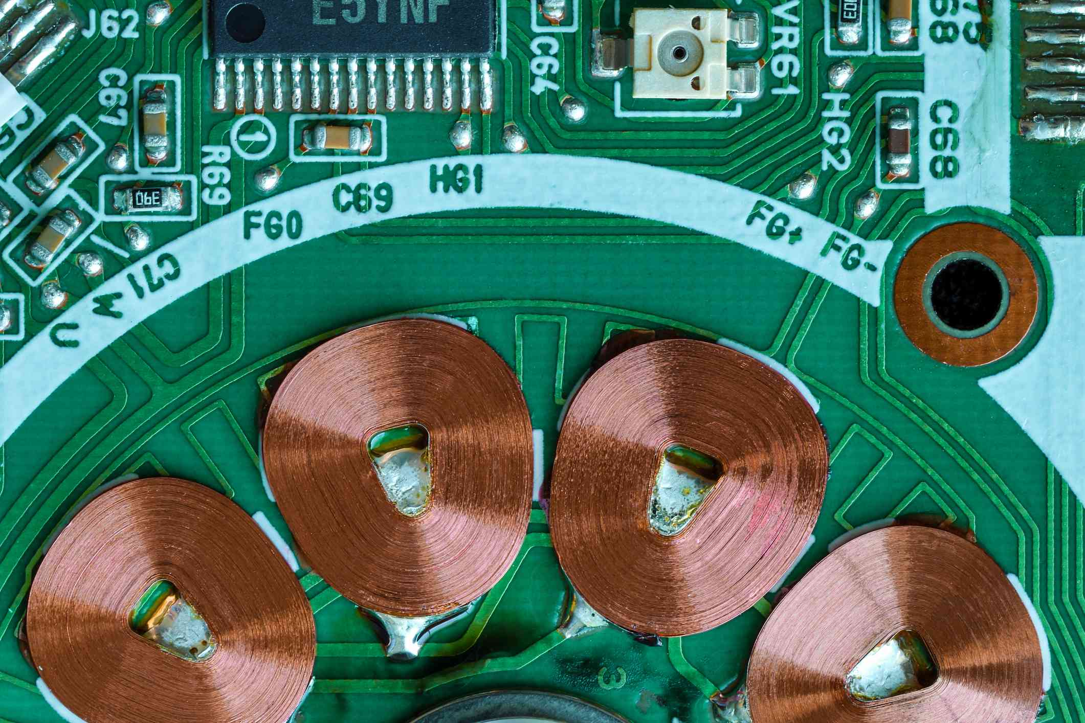 Shot from above a circuit board showing copper coils