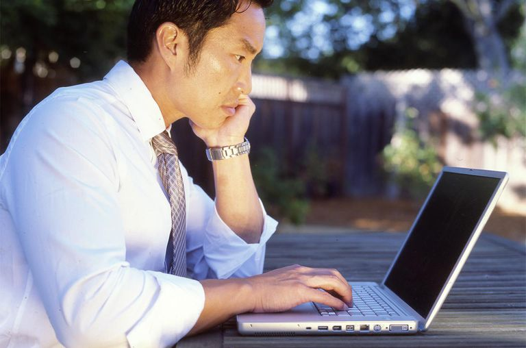 Man working outside at computer