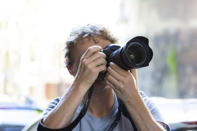 Man taking picture using a DSLR camera
