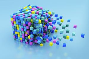 Small multicolored blocks assembling in large cube shape on blue background