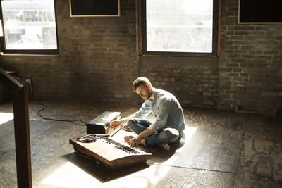 Man playing keyboard in studio