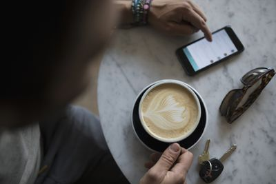 man with coffee and smartphone