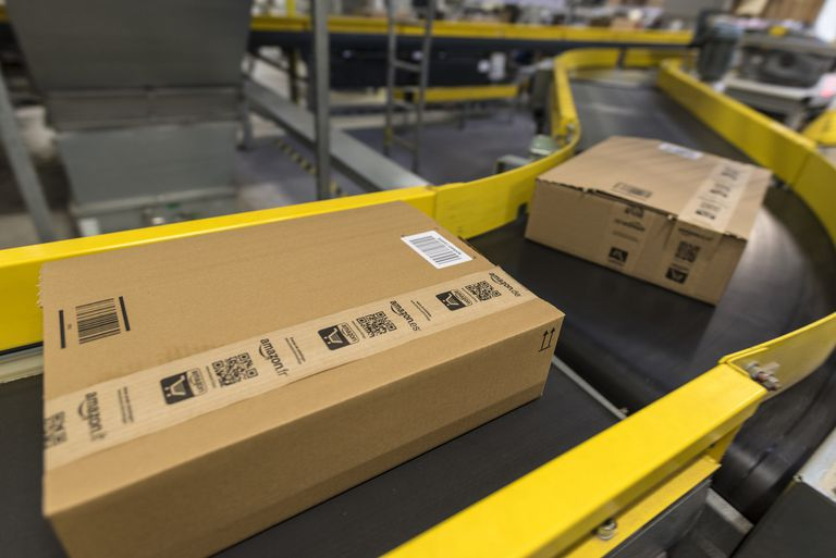 Amazon boxes on conveyor belts showing the shipping process