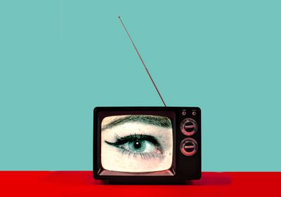 Photo of an old TV with an eye filling up the screen.